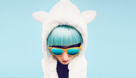 Fashion girl in hoodie Teddy Bear on a blue background Stock Image
