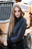 Fashion girl in a jacket next to the construction Royalty Free Stock Photos