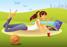 Fashion girl with laptop in the park Stock Images