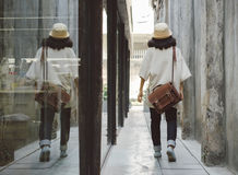 Fashion girl with leather bag at alleyway Royalty Free Stock Photography