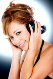 Fashion girl listening to music Stock Images