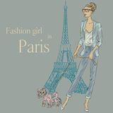 Fashion girl with little dog near Eiffel tower. Hand drawn illustration Background with model Stock Photography