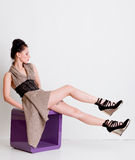 Fashion girl with long legs posing in studio Stock Photos