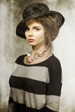 Fashion girl with lovely hat Royalty Free Stock Photography