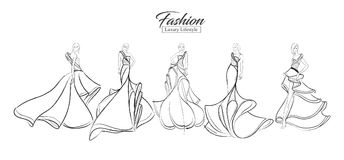 Fashion girl. Luxury lifestyle. A set of fashion sketches. Autumn-winter 2018. Fashion girls on a white background in beautiful evening dresses Royalty Free Stock Image