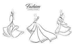 Fashion girl. Luxury lifestyle. A set of fashion sketches. Autumn-winter 2018. Fashion girls on a white background in beautiful evening dresses Stock Photography