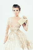 Fashion Girl. Makeup, Gold Dress and Clutch Stock Image