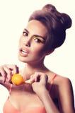Fashion girl with mandarin Royalty Free Stock Photos