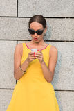 Fashion girl with mobile phone Royalty Free Stock Images