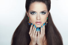 Fashion girl model. Manicured nails. Beautiful woman with Profes. Sional make-up and healthy hair styling Stock Image