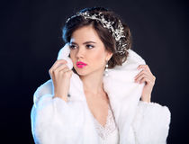 Fashion girl model in white fur coat, luxury jewelry, elegant ha Royalty Free Stock Photography