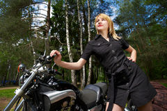 Fashion girl and motorcycle Stock Images