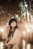 Fashion girl at night alley. Retro style. Stock Photos