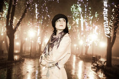 Fashion girl at night alley. Retro style. Royalty Free Stock Photo