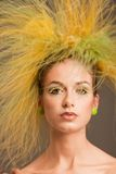 Fashion girl with original hairstyle. In the studio Stock Image