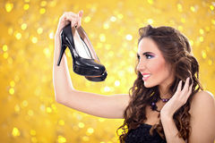 Fashion girl with pair of high heels Royalty Free Stock Images