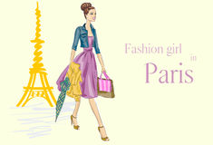 Fashion girl in Paris near Eiffel Tower Stock Photography