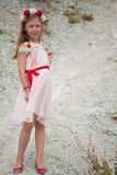 Little 7 years girl in pink dress outside Royalty Free Stock Photography