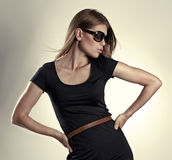 Fashion girl. Fashion portrait of young glamour blonde female model posing in studio Royalty Free Stock Photo