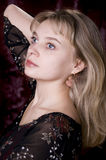 Fashion girl posing on dark background Royalty Free Stock Image