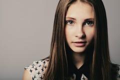 Fashion girl posing on grey background Stock Photo