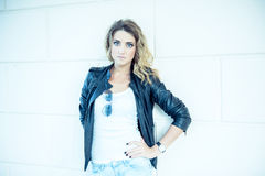 Fashion girl posing with leather jacket Stock Photography