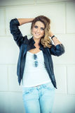 Fashion girl posing with leather jacket Royalty Free Stock Images