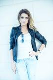 Fashion girl posing with leather jacket Stock Photo
