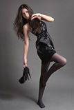 Fashion girl posing in the studio Royalty Free Stock Photos