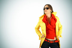 Fashion girl posing with sunglasses Stock Image