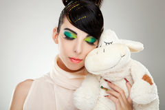 Fashion girl posing with teddy Stock Image