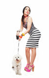 Fashion girl with puppy dog Royalty Free Stock Photography