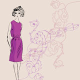 Fashion girl in purple dress Stock Image