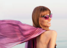 Fashion girl with a purple scarf Stock Images
