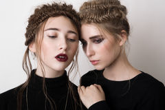 Fashion girl put her hand on the shoulder of his friend Royalty Free Stock Photos