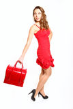 Fashion girl in a red dress with a red bag isolated on white bac Stock Photography