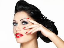 Fashion girl with red lips and nails Royalty Free Stock Photos