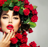 Fashion Girl Red Roses Hairstyle. Beauty Fashion Model Girl Portrait with Red Roses Hairstyle Royalty Free Stock Image