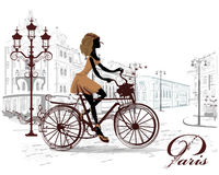 Fashion girl rides a bicycle, decorated with a musical stave Stock Photos