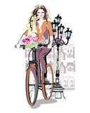 Fashion girl rides a bicycle Stock Photo