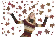 Fashion girl rising up her arms. Fashion shot of a natural blonde girl in a striped woolen dress rising her arms in the air and smiling stock photos