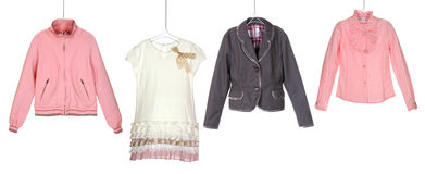 Fashion girl's clothes on hangers Royalty Free Stock Image