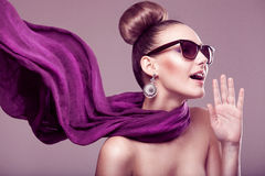 Fashion girl with a scarf. Fashion girl with a purple scarf, wearing sunglasses, updo Stock Photo