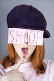 Fashion girl with SHOP word on eyes. Royalty Free Stock Photo