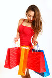 Fashion girl with shopping bags isolated on white background Stock Photos