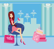 Fashion girl shopping in shoe shop Royalty Free Stock Image