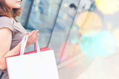 Fashion girl shopping with white bags at Milan, Italy Royalty Free Stock Image