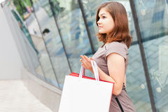 Fashion girl shopping with white bags at Milan, Italy Royalty Free Stock Photos