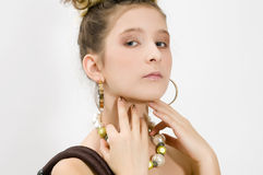 Fashion girl showing jewels Stock Photography