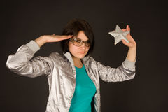 Fashion girl in silver jacket holding star Stock Photos